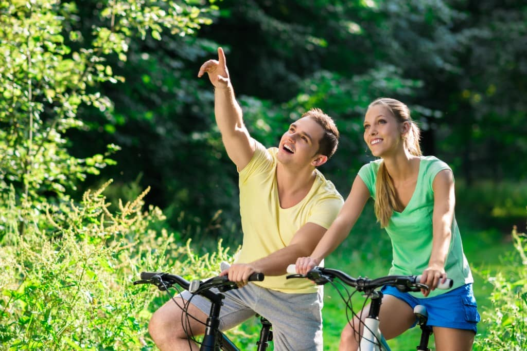 Happy couple on bicycles in summer